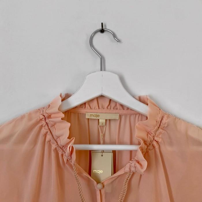 Blusa en rosa empolvado